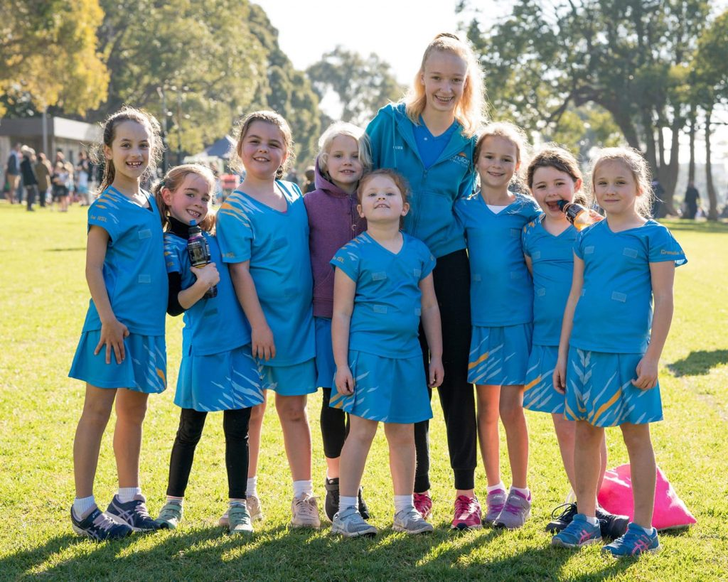 Cronulla RSL junior netball team with coach